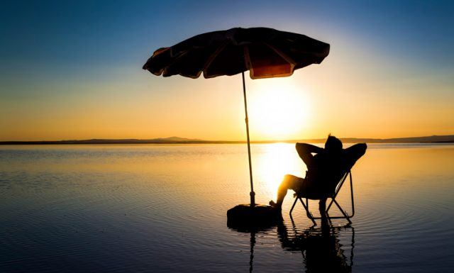 Young man relaxing at sunset