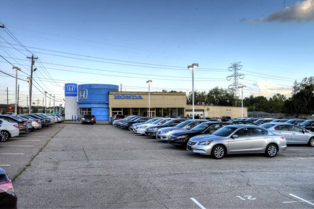 A Honda dealership readies for another day of handling car buyers and servicing vehicles