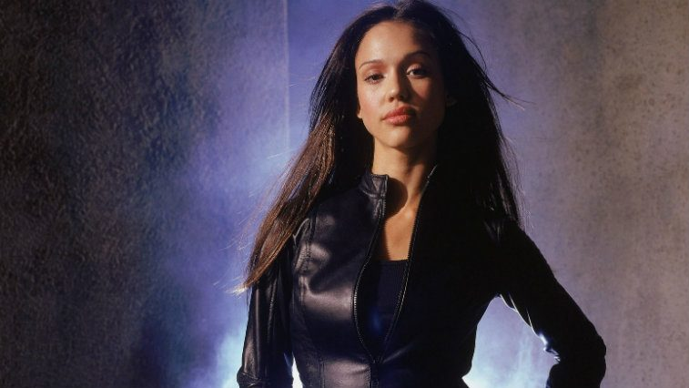 Jessica Alba is wearing a black leather outfit in Dark Angel.