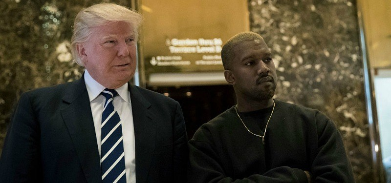 Kanye West and Donald Trump stand together in the lobby of Trump Tower
