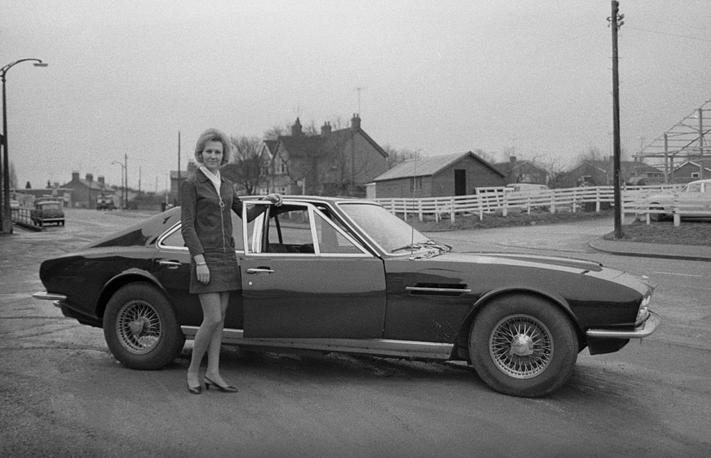 Pat Brown poses next to a Lagonda
