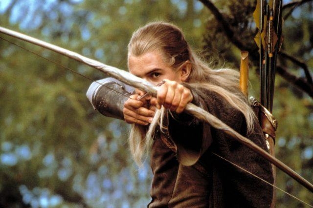 Legolas (Orlando Bloom) aims with his bow and arrow in 'The Lord of the Rings'