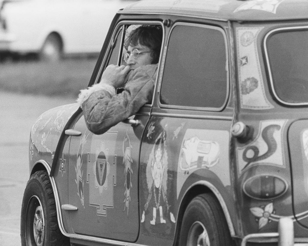John Lennon of the Beatles in a psychedelic Radford Mini de Ville