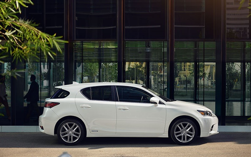 Profile view of white 2017 Lexus CT 200h from passenger side
