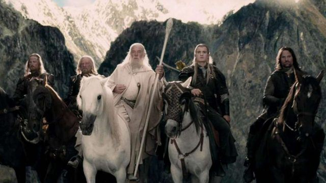 Denethor, Gandalf, Legolas and Aragorn ride horses in a scene from 'Lord of the Rings: The Two Towers'