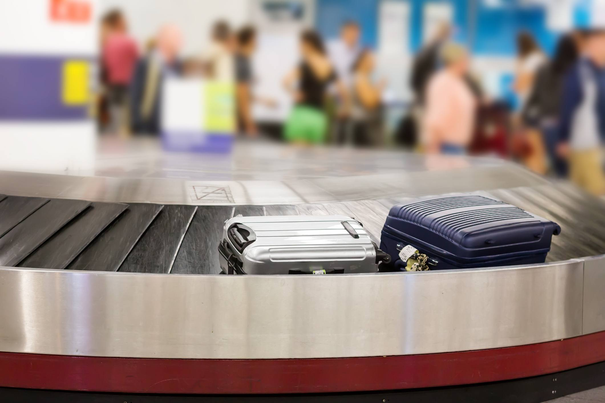 Two suitcases on the luggage belt in the airport