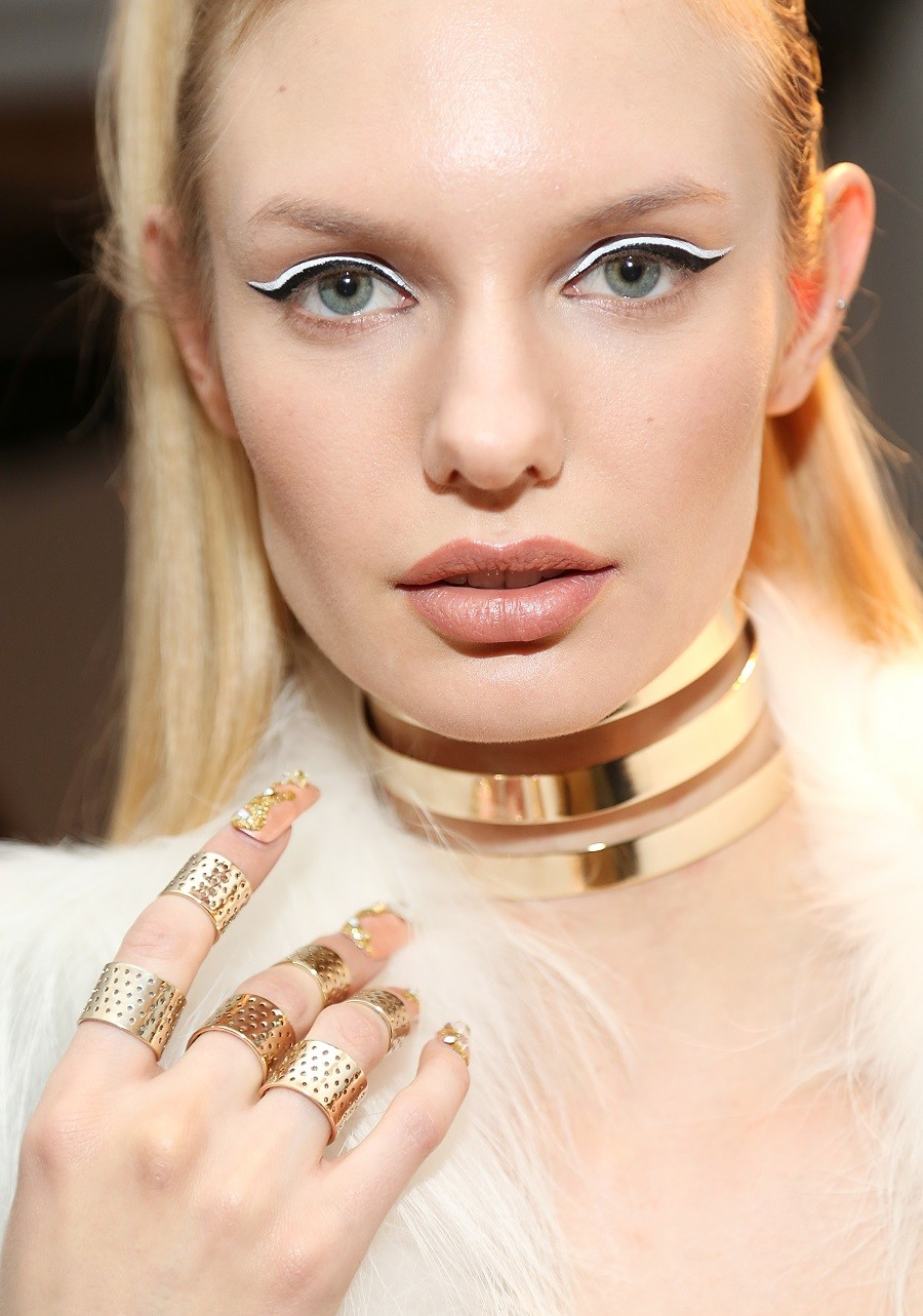 A model prepares backstage at The Blonds fashion show