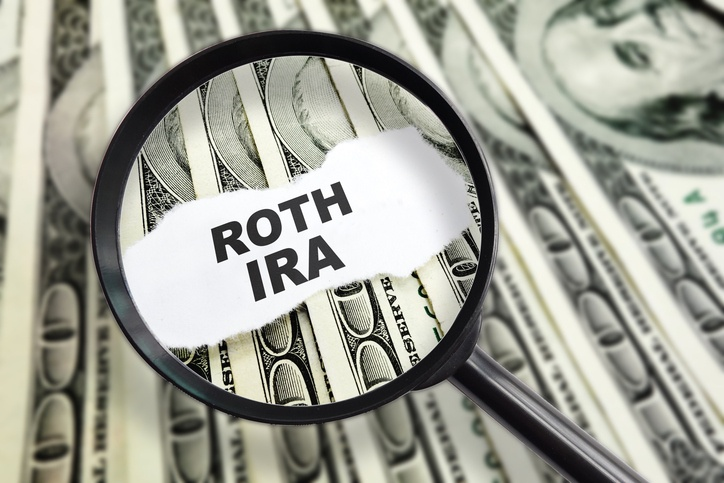 Magnified ROTH IRA message on dollar bills