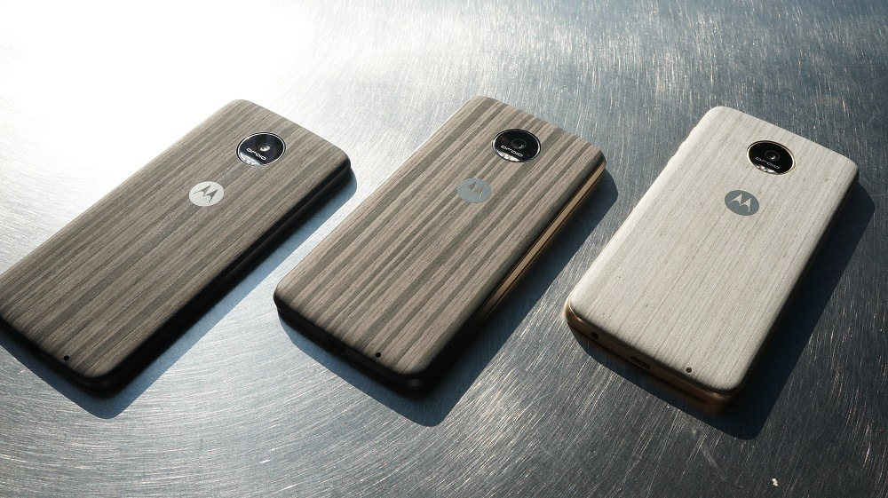 3 Moto Z smartphones with style mods on the back