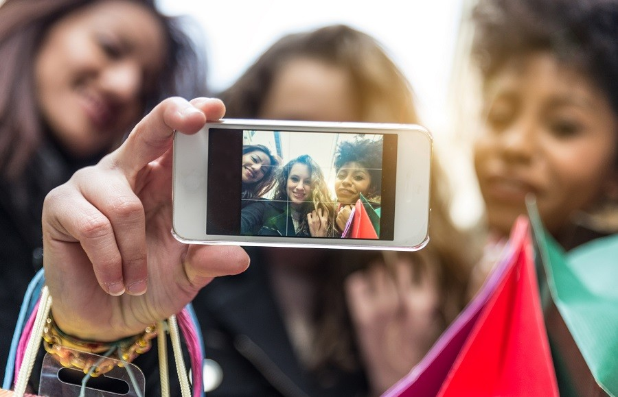 attractive young women of different ethnics taking a selfie