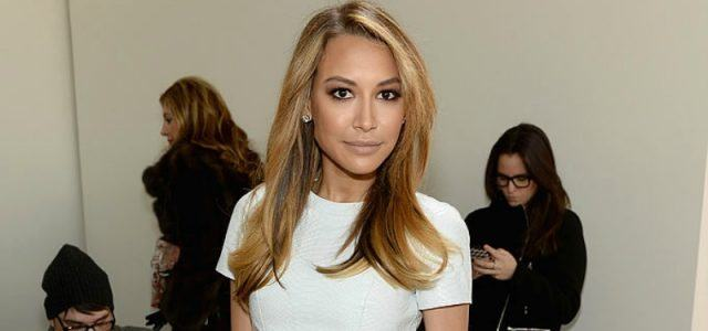 Naya Rivera posing for a photo in a white T-shirt.