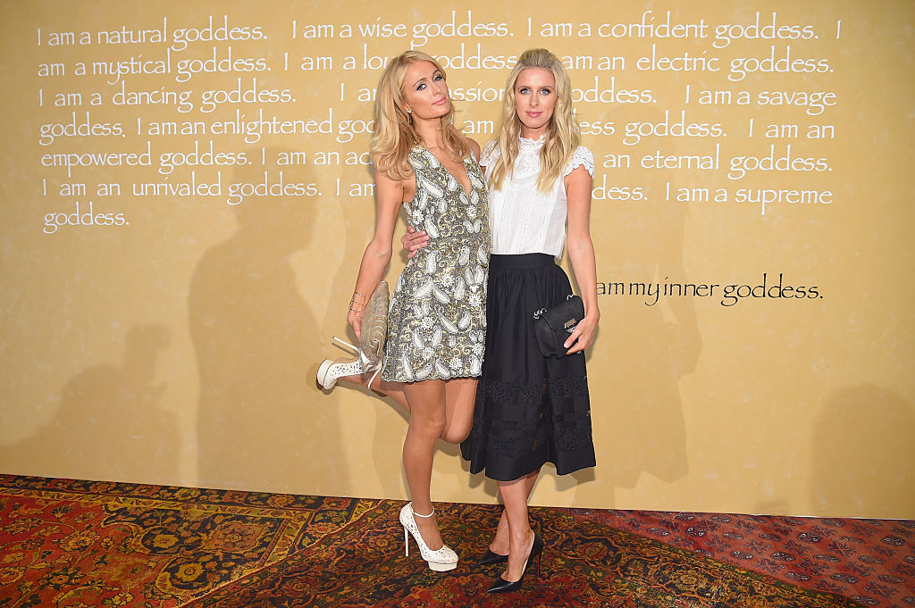 Paris Hilton (L) and Nicky Hilton Rothschild attend Alice + Olivia By Stacey Bendet Spring 2016