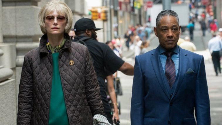 Tilda Swinton walks next to a man in Okja