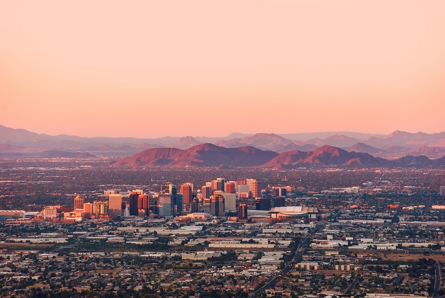 Phoenix with its downtown lit by sun