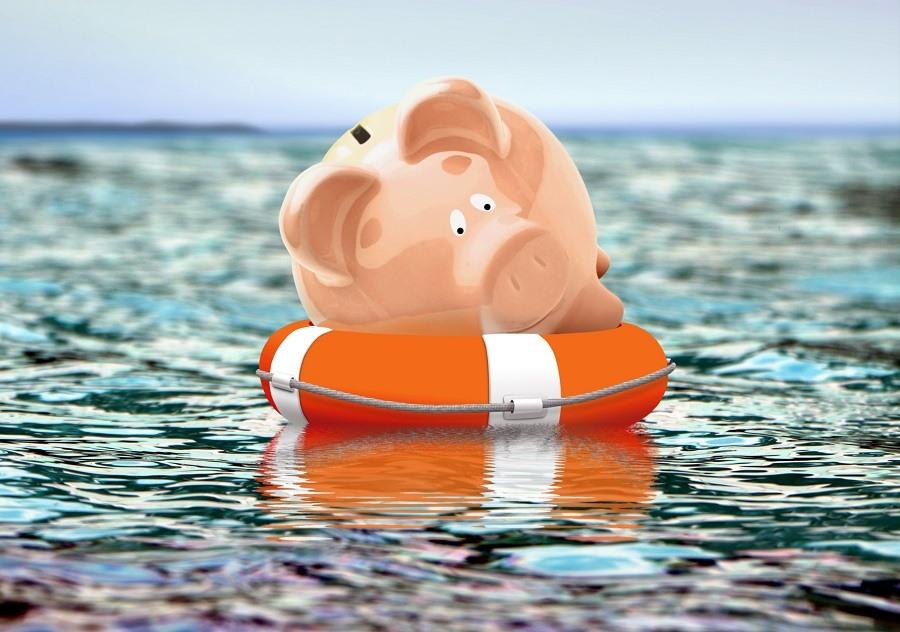 Piggy bank on buoy floating