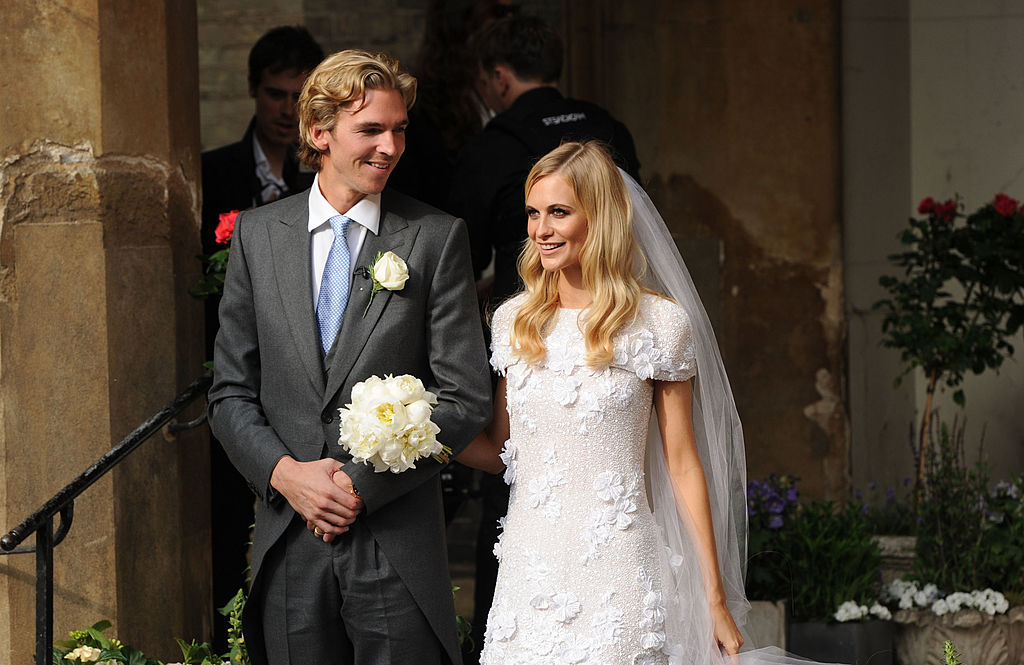 James Cook and Poppy Delevingne depart St. Paul's Church after their wedding