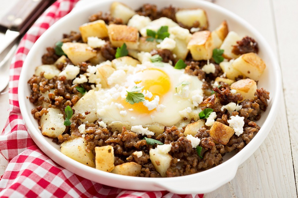 Potato hash with sausage and fried egg