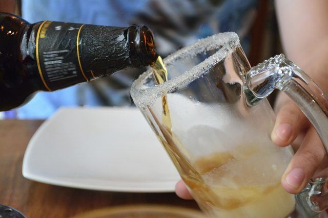 Bartender pouring a beer into a glass
