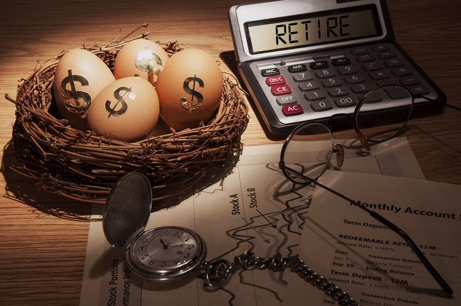 illustration of retirement planning with a calculator and eggs in a nest with dollar signs