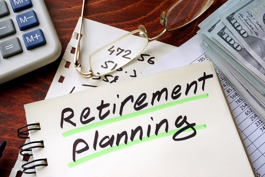 Retirement planning written on a notepad