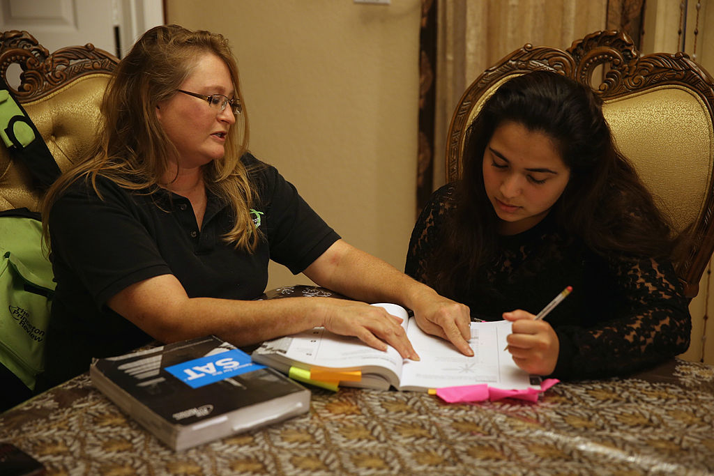 An English tutor helps a student