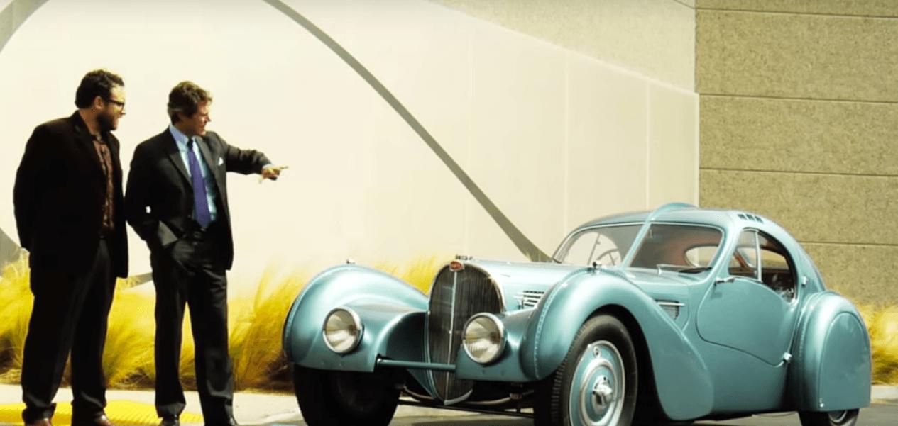Two men discussing a 1936 Bugatti Type 57S
