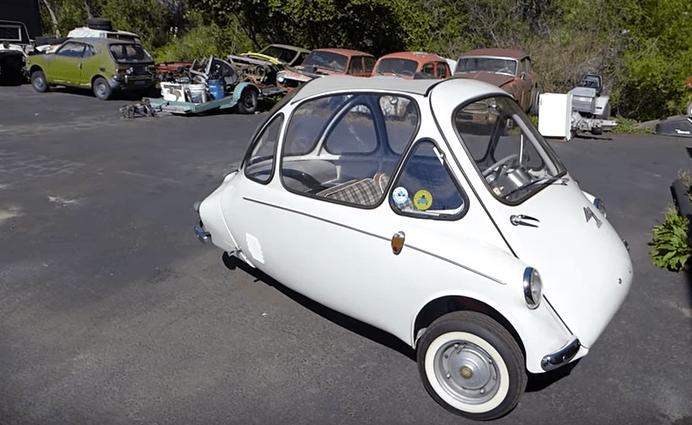 A white Heinkel Kabine parked in a parking lot