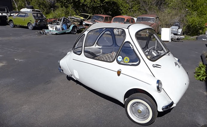 A white Heinkel Kabine parked in a parking lot