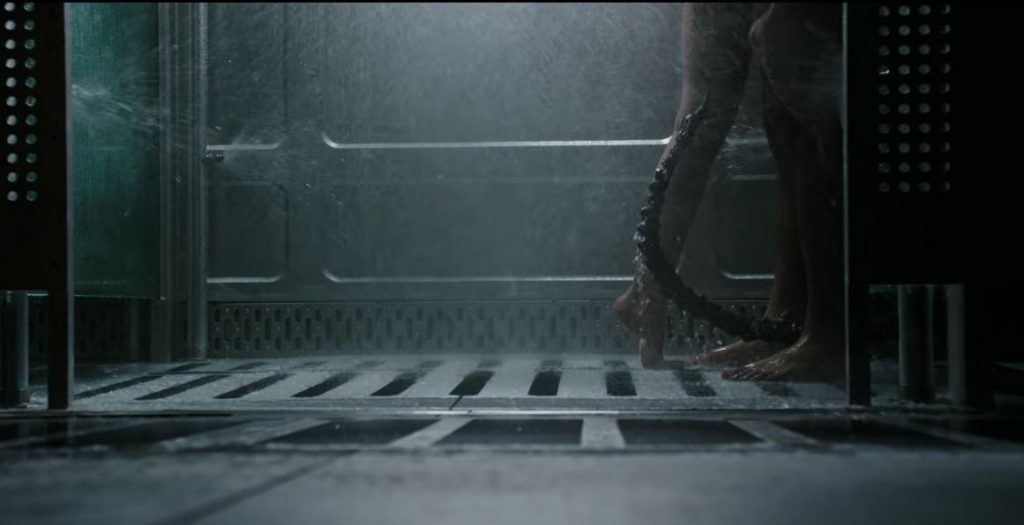 A Xenomorph sneaks into the shower on the Covenant