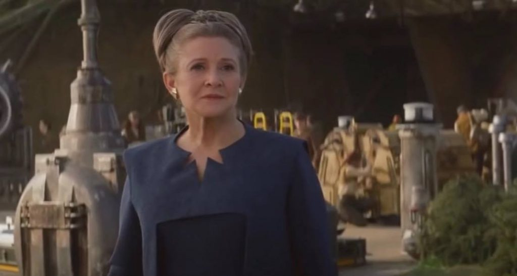 Leia is in a blue outfit in the end of Star Wars: The Force Awakens.