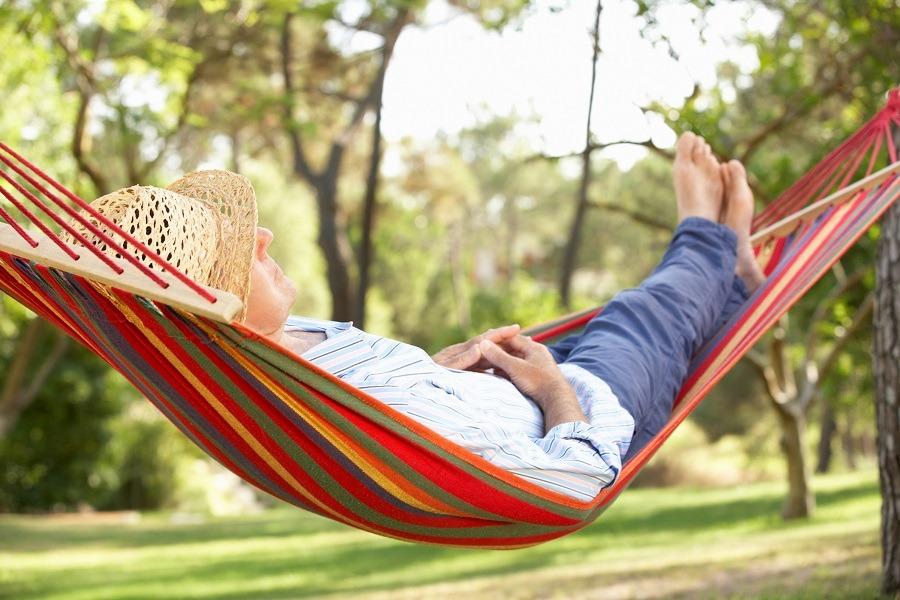 senior relaxing in hammock