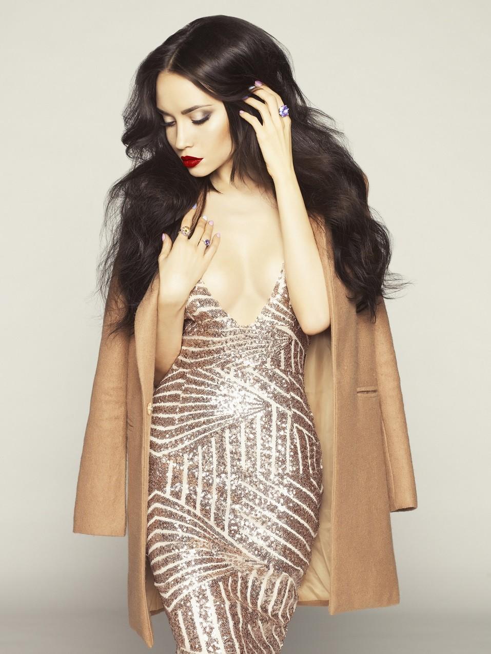 brunette model in fashion clothes posing in studio