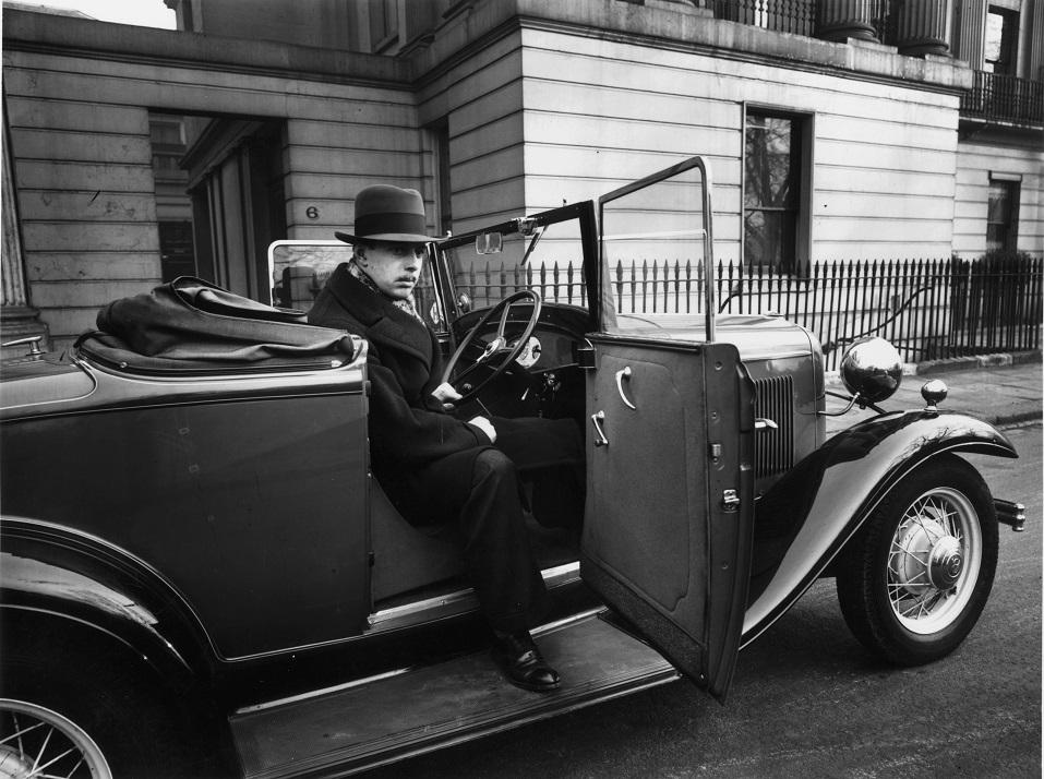 A man sitting in a Ford V8