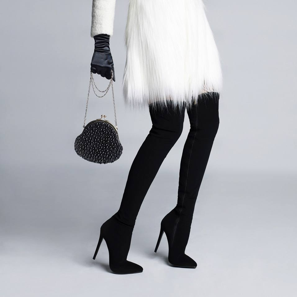 slender female legs in elegant boots stockings