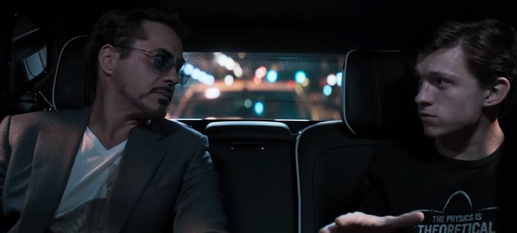 Tony Stark and Peter Parker speak to each other in the back seat of a car