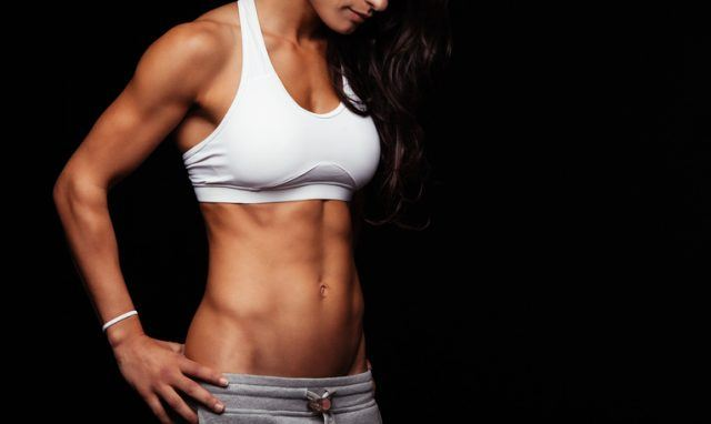 Fitness female model torso with her hands on hips