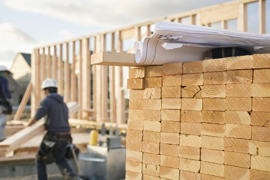 stacks of 2x4 boards at a construction site