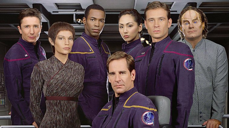 The cast of Star Trek: Enterprise poses on a space craft