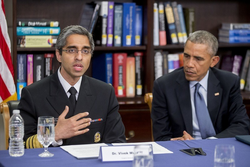Vivek Murthy, U.S. surgeon general, left, speaks while participating in a roundtable discussion along with President Obama