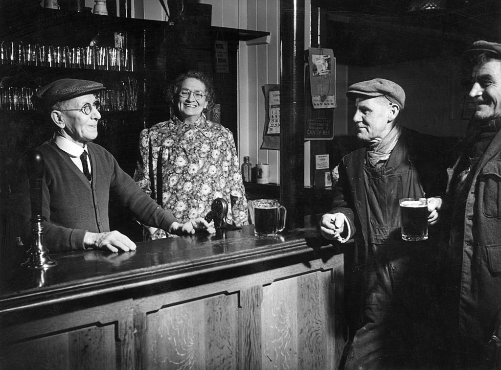 The regulars and bar staff at a public house in Windlesham, Surrey