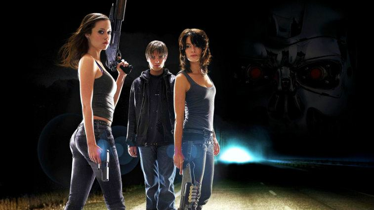 The cast of Terminator: The Sarah Connor Chronicles poses together holding weapons