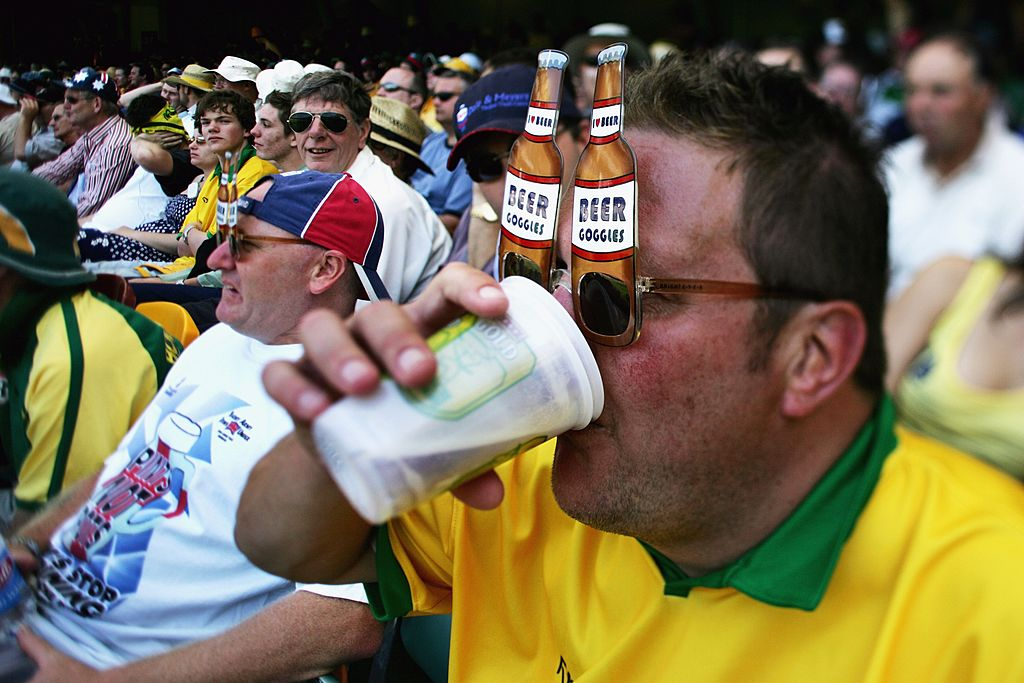 A member of the Fanatics drinks beer at the Gabba cricket ground