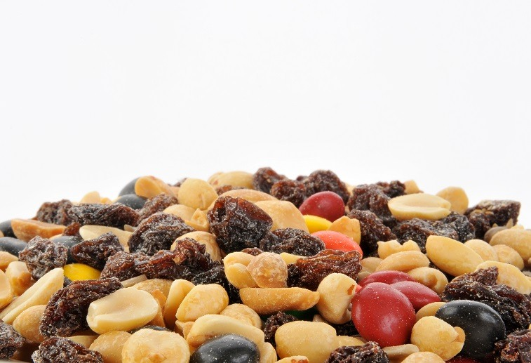 trail mix background of peanuts, raisins and candy