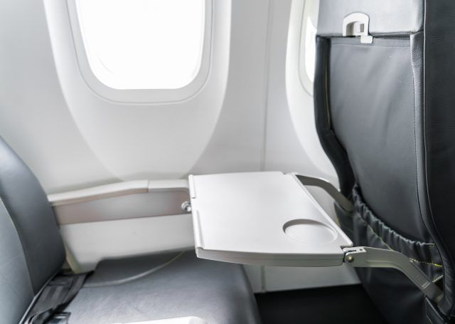 Tray on back of aeroplane seat