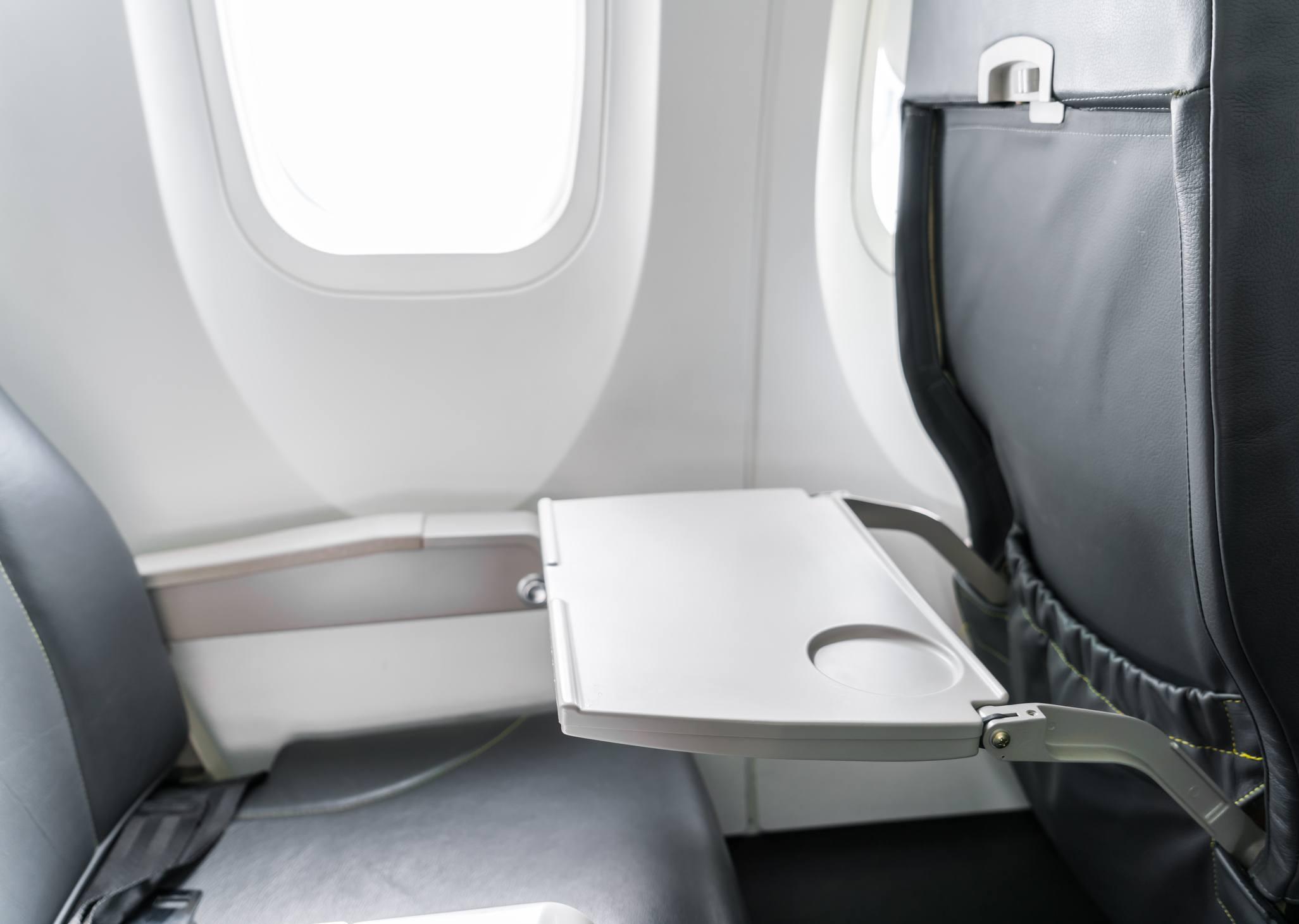 Tray on back of aeroplane seat