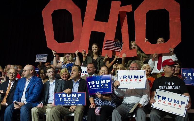 Supporters cheer for Donald Trump during a rally in Canton