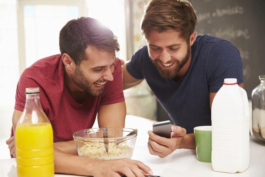Two Male Friends Having Breakfast