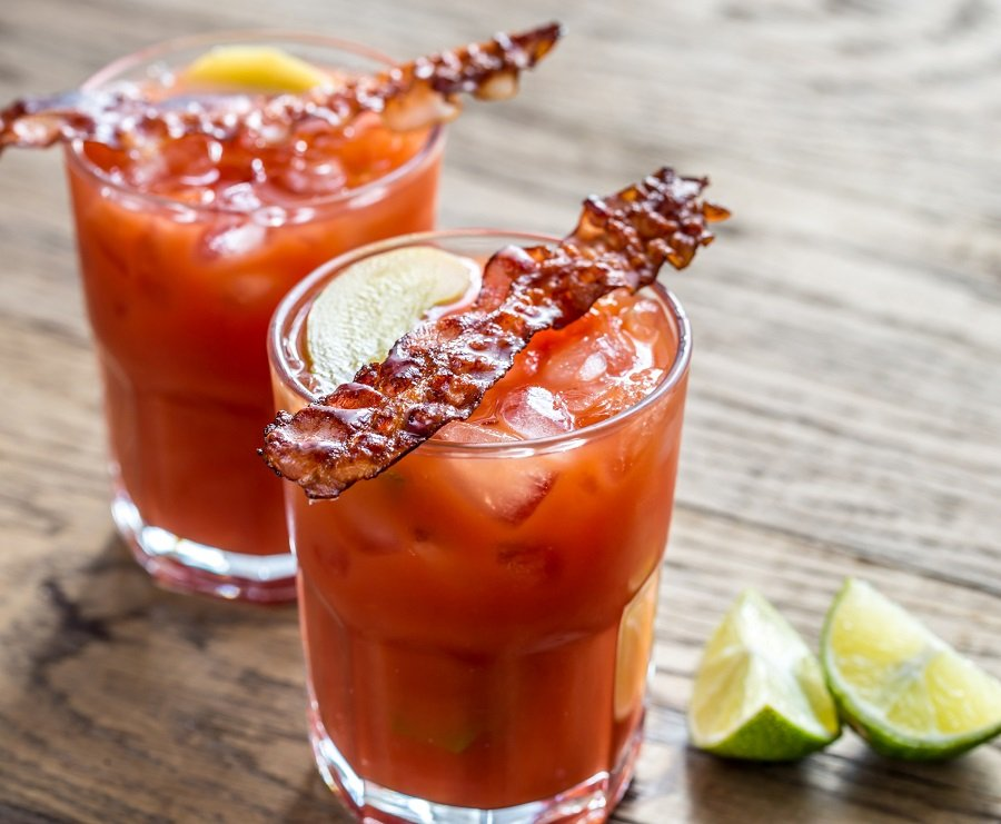 Two glasses of Bloody Mary with bacon