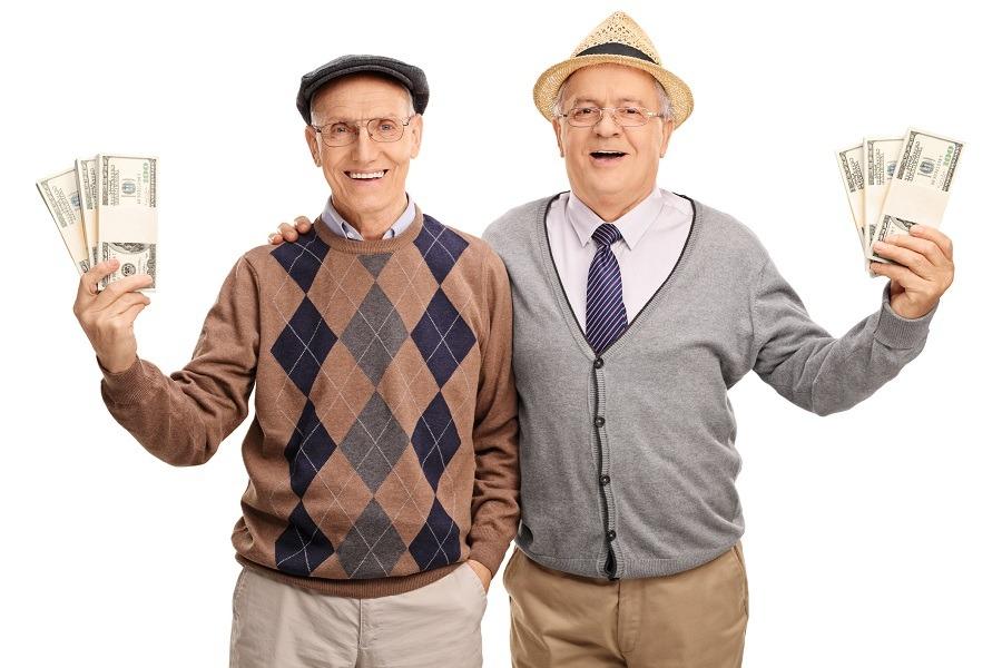 Two senior gentlemen holding several stacks of money