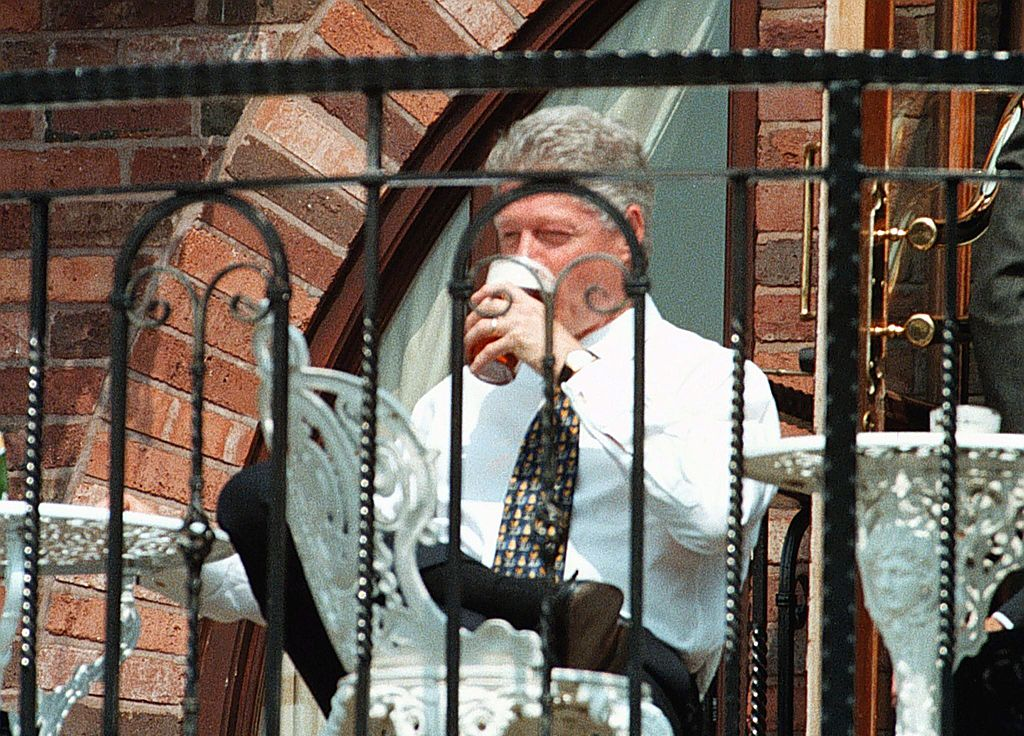 US President Bill Clinton enjoys a pint of beer during his walkabout at the Malthouse